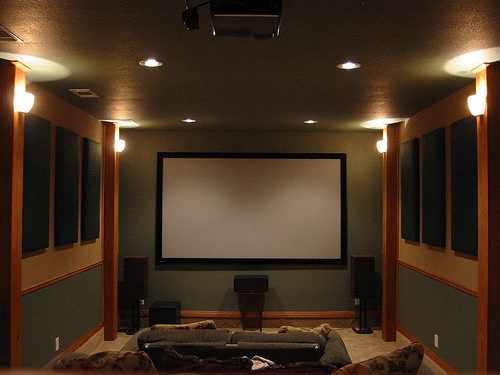 A typical home theater setup with projector and 100-inch screen