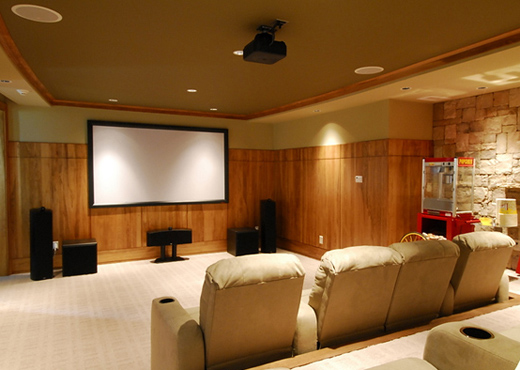 A home theater setup with projector, a large screen and full complement of speakers and sub-woofers will enhance your home movie experience. Popcorn machine on the right is optional :-)